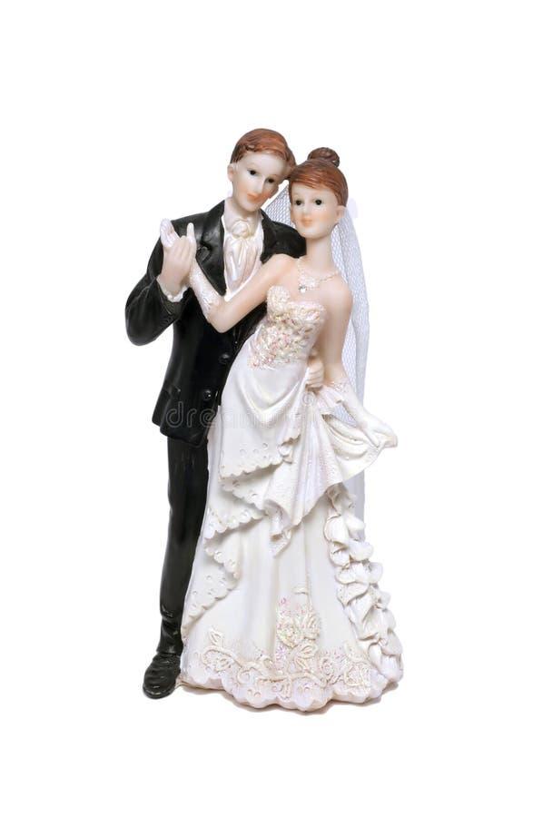 Estatuilla de novia y del novio del pastel de bodas fotografía de archivo libre de regalías