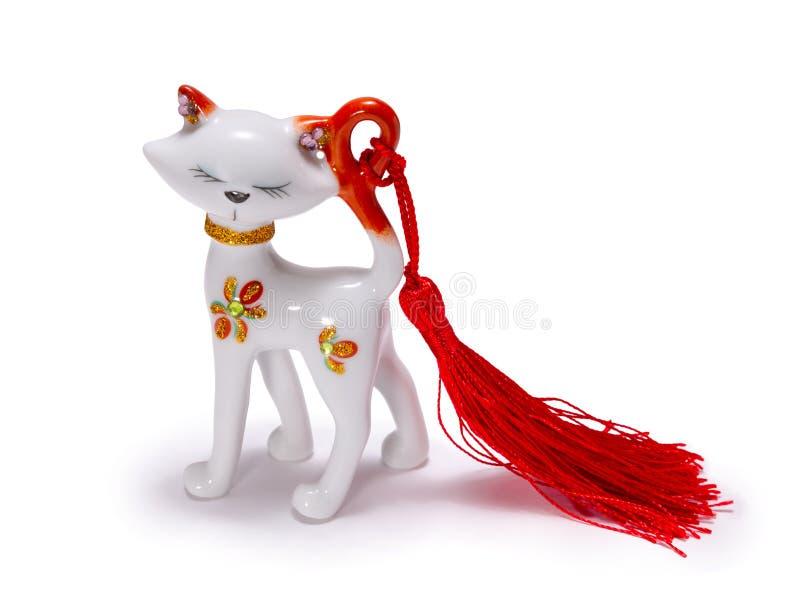 Estatuilla hermosa de un gato blanco imagenes de archivo