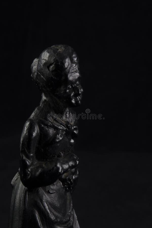 Estatuilla negra del carbón fotografía de archivo libre de regalías