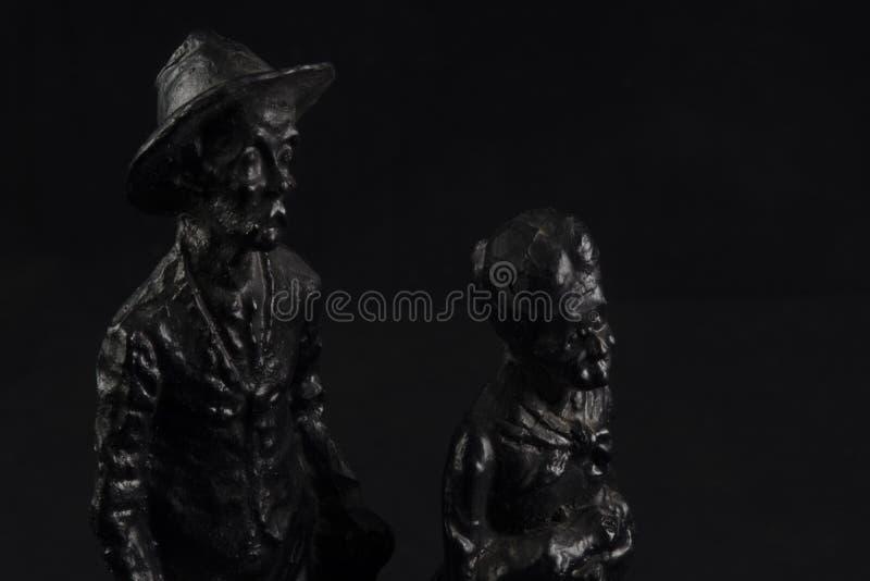 Estatuillas negras del carbón imagenes de archivo