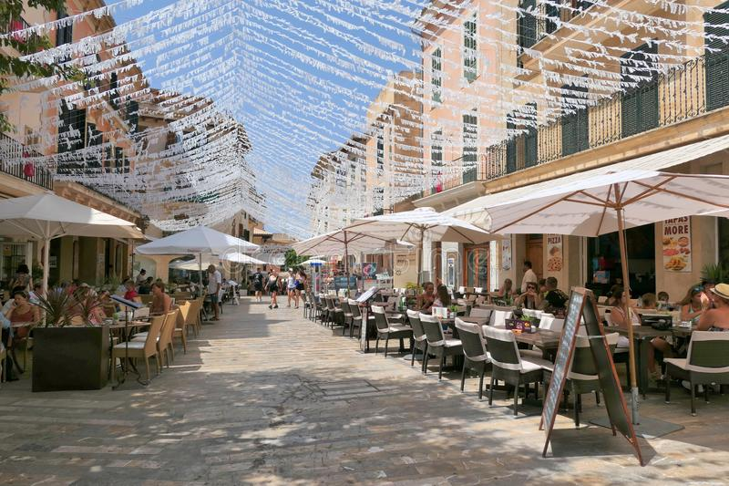 Restaurant tables on street in seaside Alcudia old town, Mallorca stock photo
