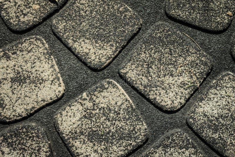 Esteira de borracha cinzenta escura foto de stock