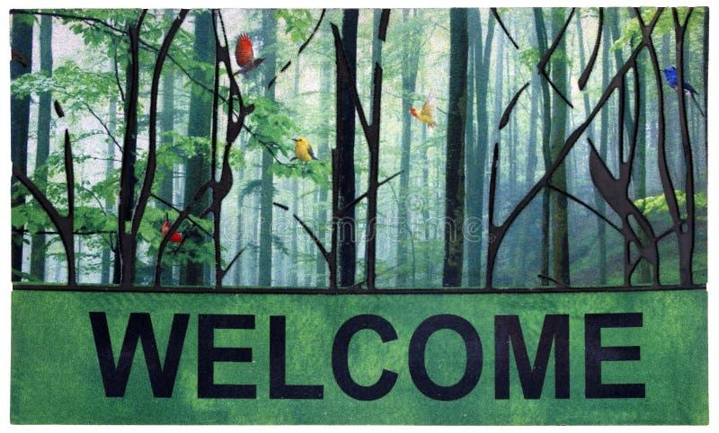 Esteira de porta exterior verde, preta e multicolorido bonita com árvores, pássaros e texto bem-vindo foto de stock