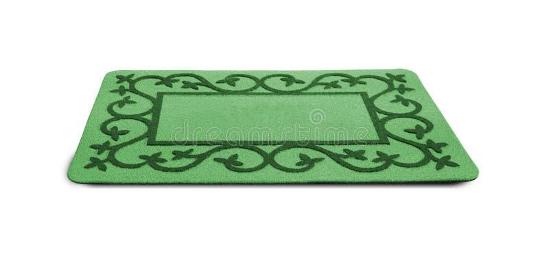 Esteira de porta verde bem-vinda fotografia de stock