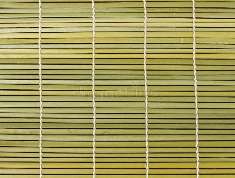 Esteira marrom de bambu da palha como o fundo abstrato da textura foto de stock