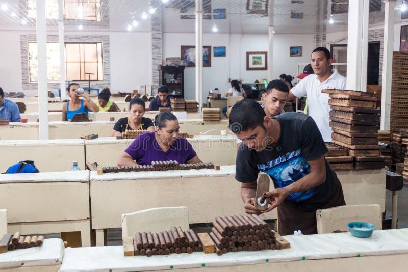 ESTELI, NICARAGUA - APRIL 21, 2016: Workers rolling cigars at Tabacalera Santiago cigar factory in Estel stock photography