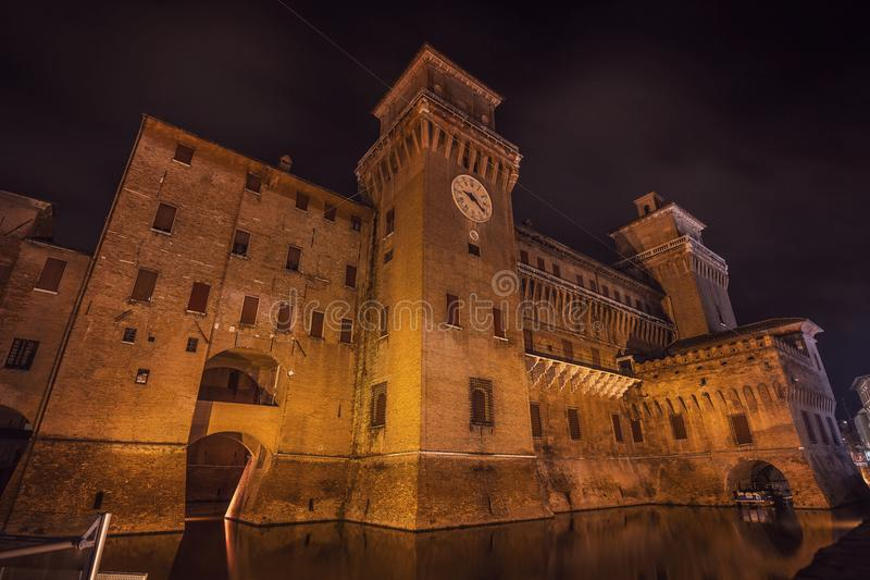 Estense Castle of Renaissance town of Ferrara at night stock photos