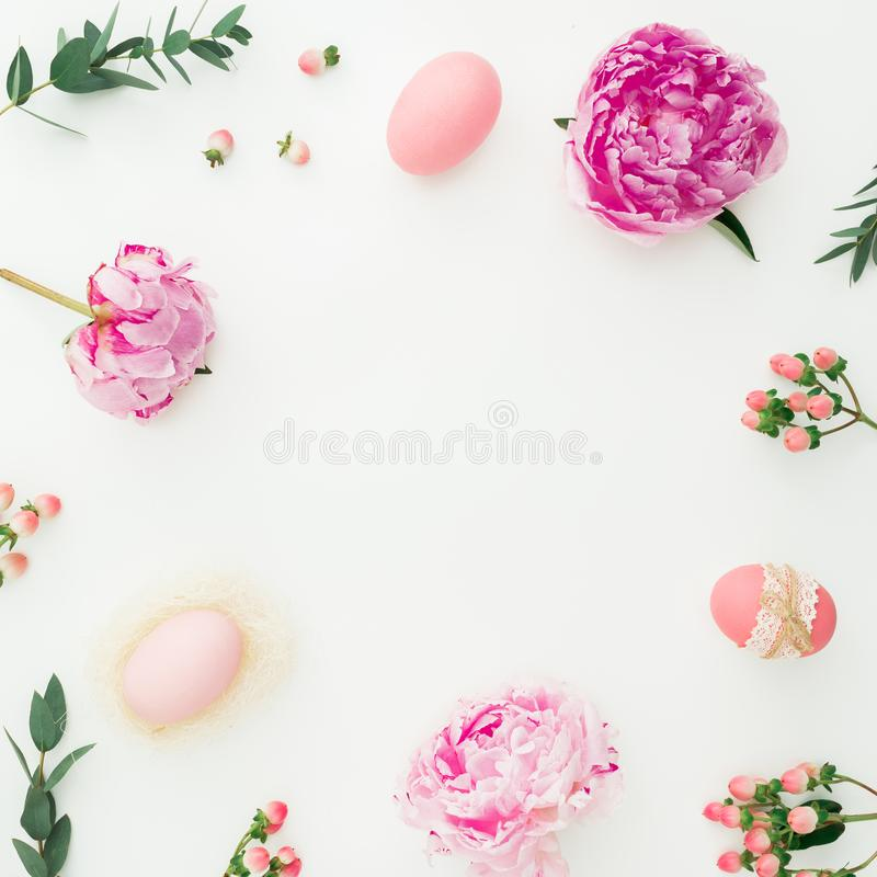Ester composition with eggs, pink peonies, hypericum and eucalyptus branches on white background. Flat lay, top view stock photo