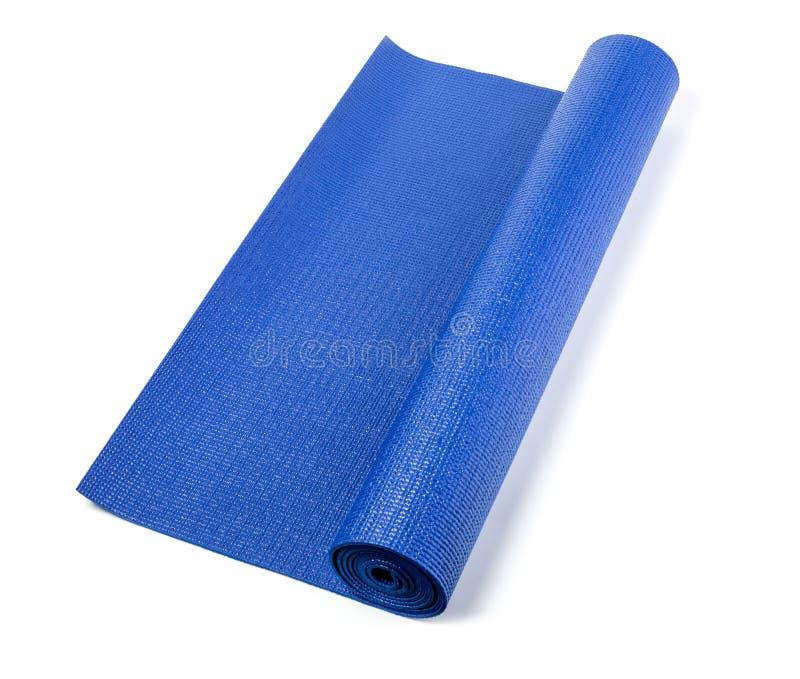 Estera azul de la yoga fotografía de archivo libre de regalías