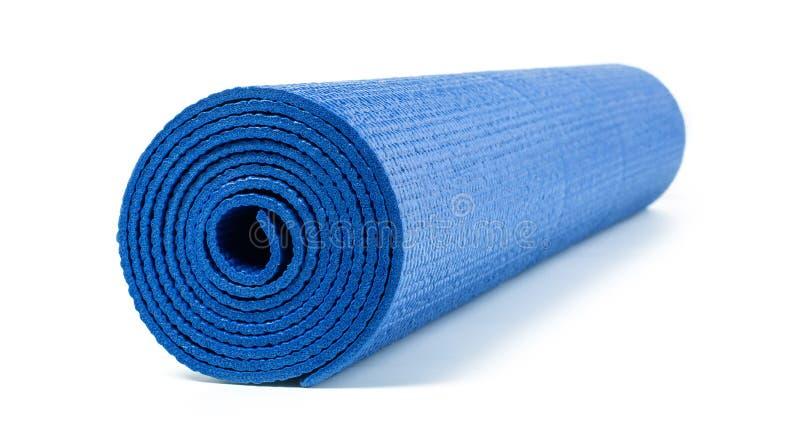 Estera azul de la yoga fotos de archivo