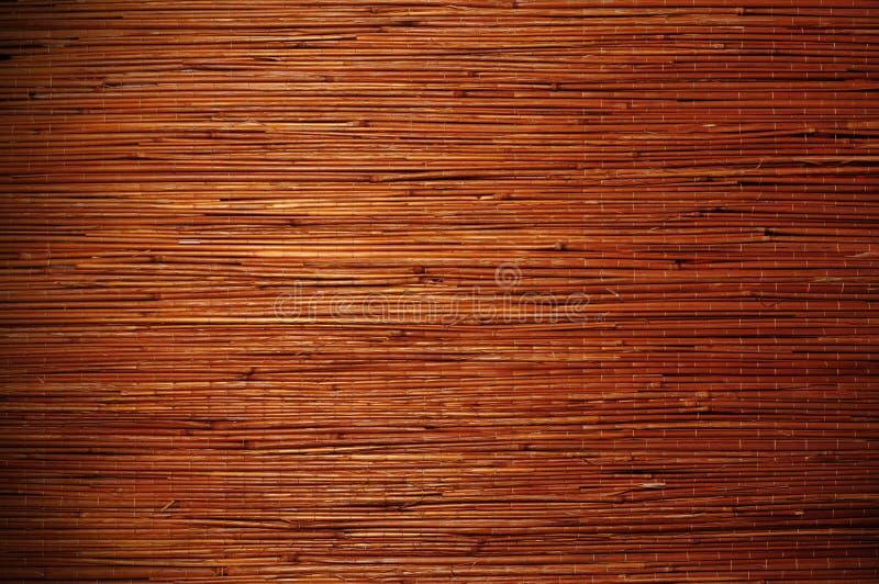 Estera marrón de bambú de la paja como fondo de la textura fotografía de archivo libre de regalías
