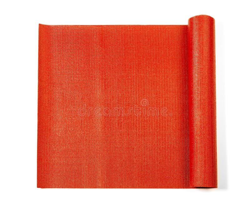 Estera roja de la yoga imagen de archivo