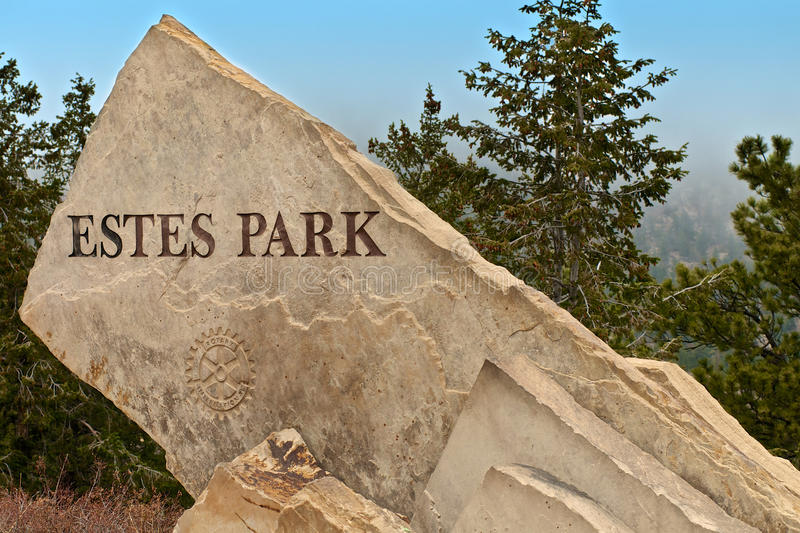 Estes Park Colorado Carved Sign. Estes Park Colorado sign carved by Rotary International that welcomes you into the Rocky Mountains Estes Park National Park in stock photo