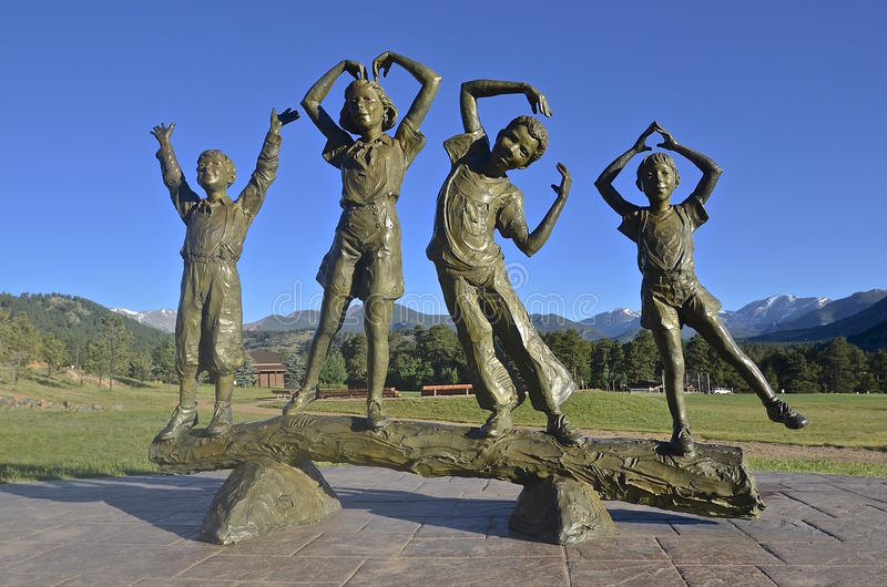 Estes Park YMCA Kids statue at the Rocky Mountain location. ESTES PARK, COLORADO, June 27, 2015: A statue of The YCMA Kids is on display at the YMCA campground stock photography