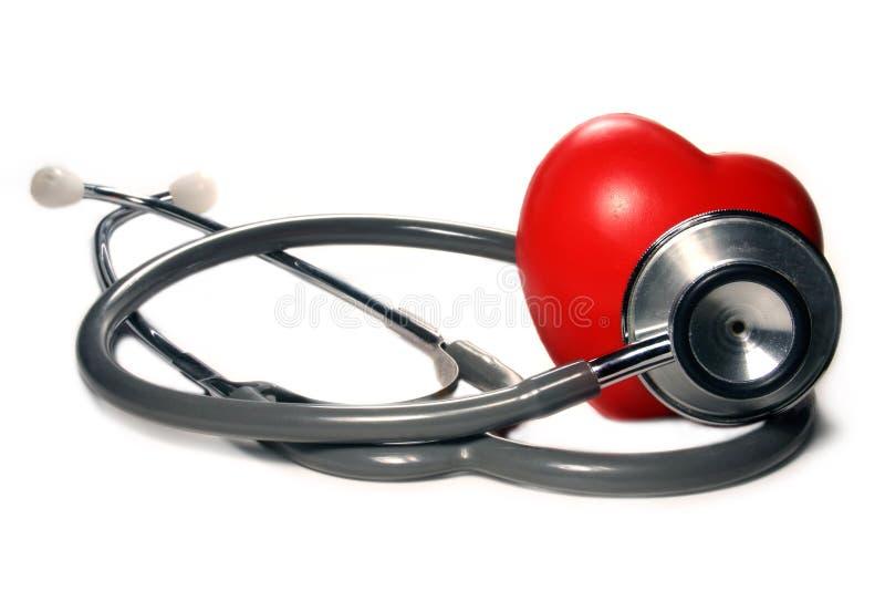 Estetoscópio com coração vermelho. imagem de stock