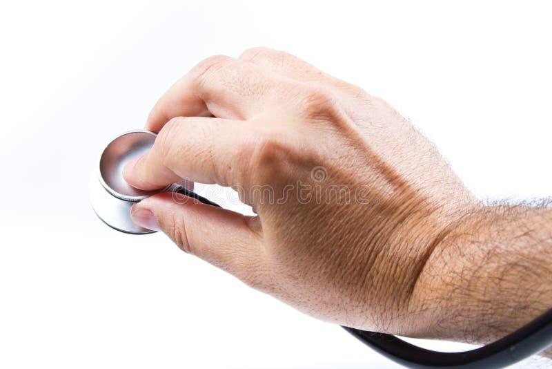 Download Estetoscópio e mão imagem de stock. Imagem de humano - 26516375