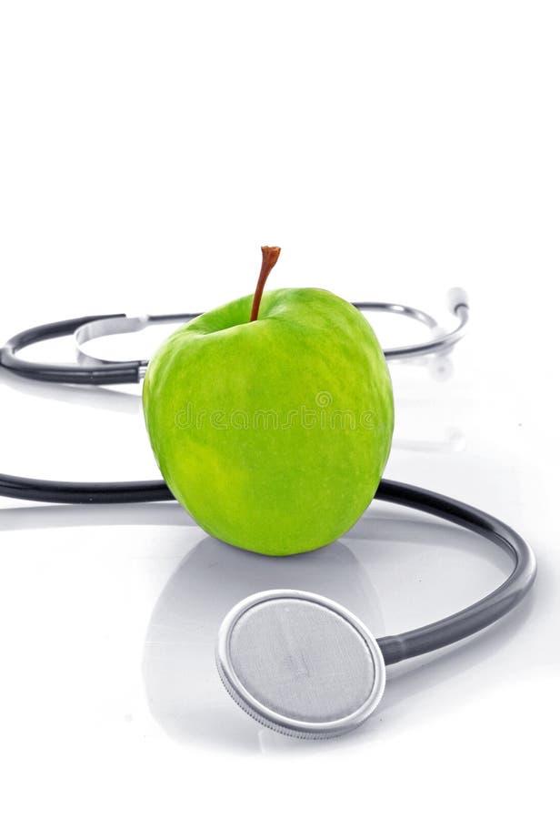 Estetoscópio e maçã imagem de stock