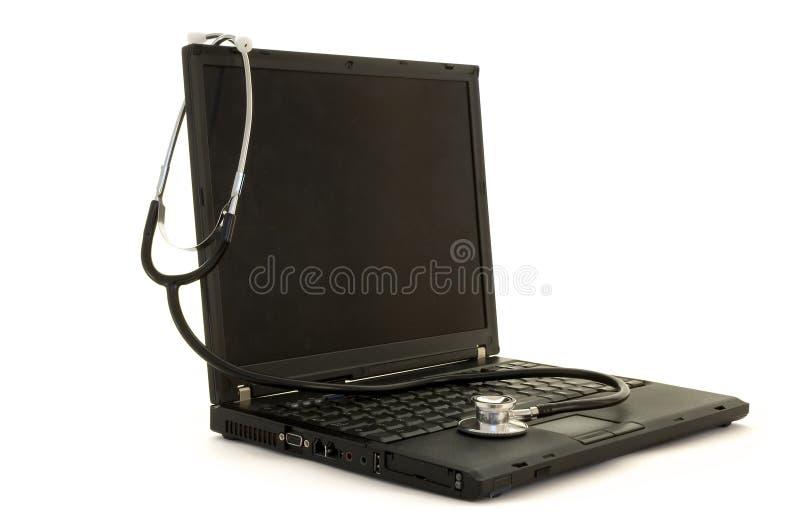 Estetoscópio em um portátil imagem de stock