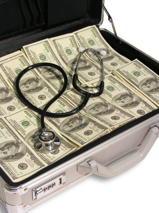Estetoscópio no dinheiro fotos de stock