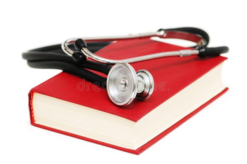 Estetoscópio No Livro Vermelho Fotos de Stock