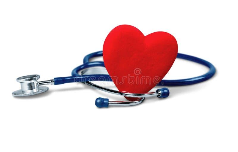 Estetoscopio médico con el corazón aislado en blanco foto de archivo libre de regalías