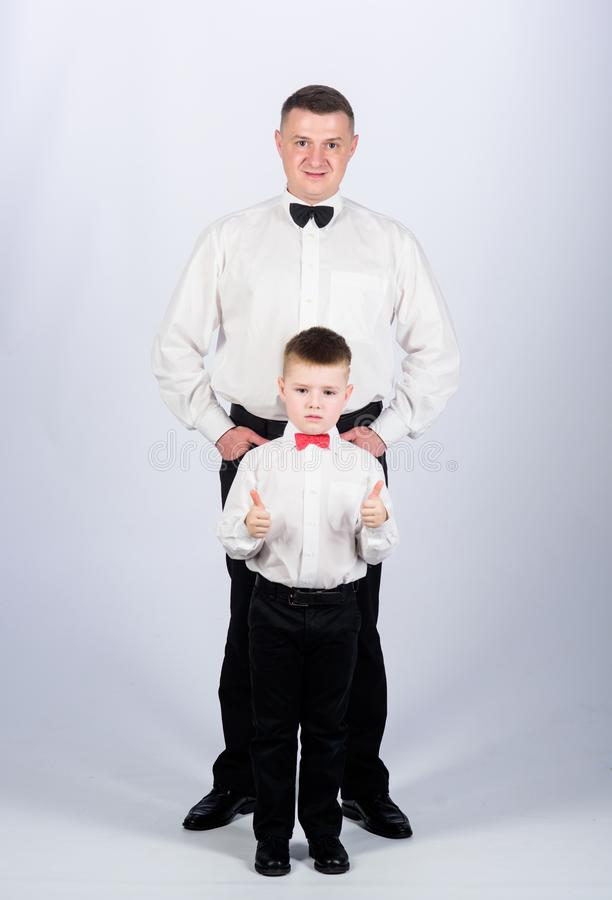Esthete. male fashion. little boy with dad businessman. family day. father and son in formal suit. watchmaker concept. Happy child with father. business stock photography