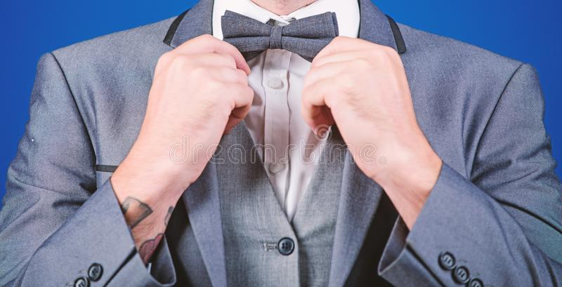 Esthete. stylish art director. businessman fix bow tie. illusionist. Bride groom ready for wedding. business man in. Formal suit. PR manager make his style stock images