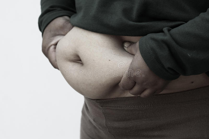 Estilo blanco y negro de la imagen para el primer de la mujer gorda en el fondo blanco Concepto para el problema de la obesidad,  imagen de archivo libre de regalías