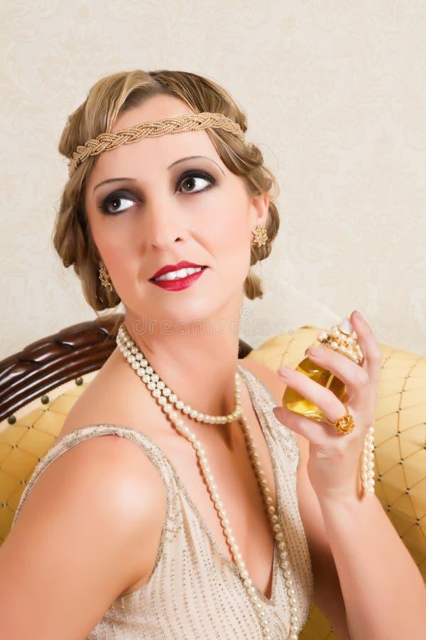 Estilo de la vendimia de los años 20 del perfume imagen de archivo