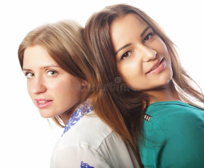Estilo de vida e conceito dos povos: Dois amigos de moça fotografia de stock