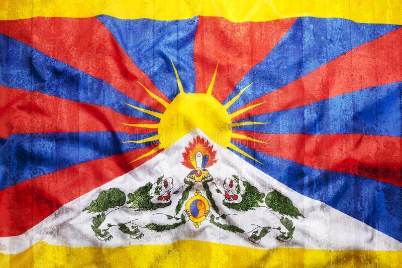 Estilo do Grunge da bandeira de Tibet na parede de tijolo imagem de stock royalty free