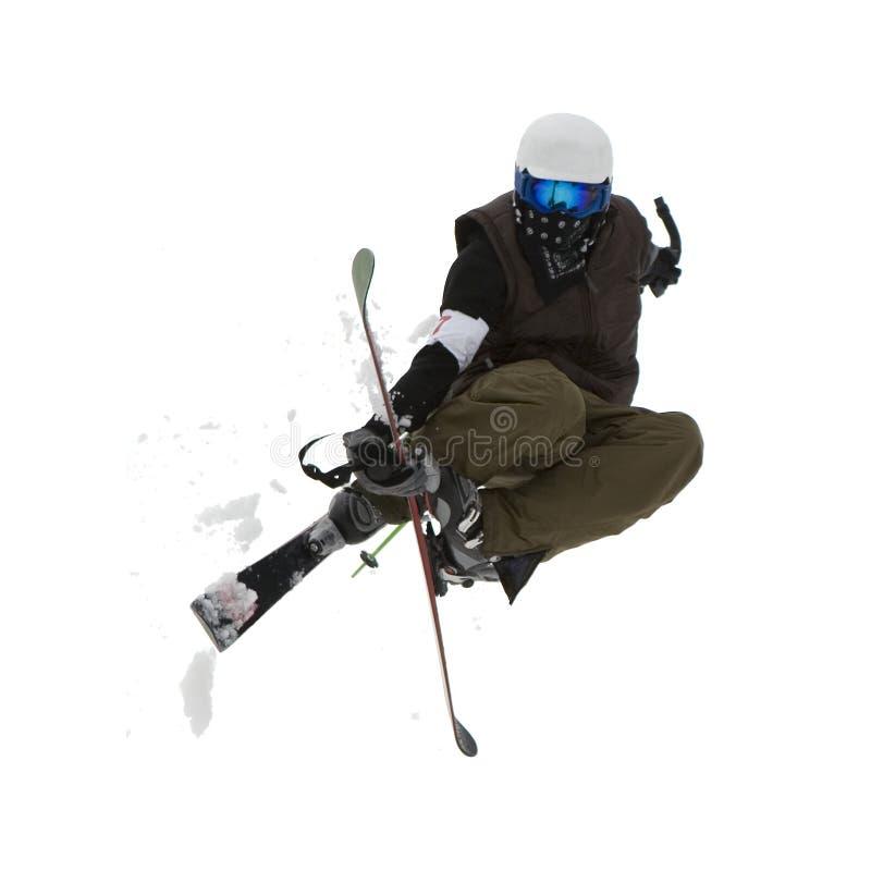 Estilo libre. Esquiador de la nieve que salta sobre blanco. imagenes de archivo