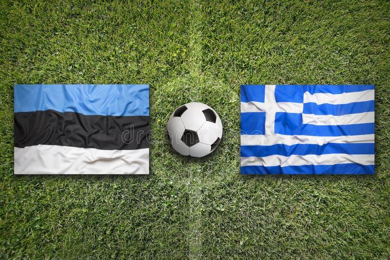 Estland versus De vlaggen van Griekenland op voetbalgebied stock afbeelding