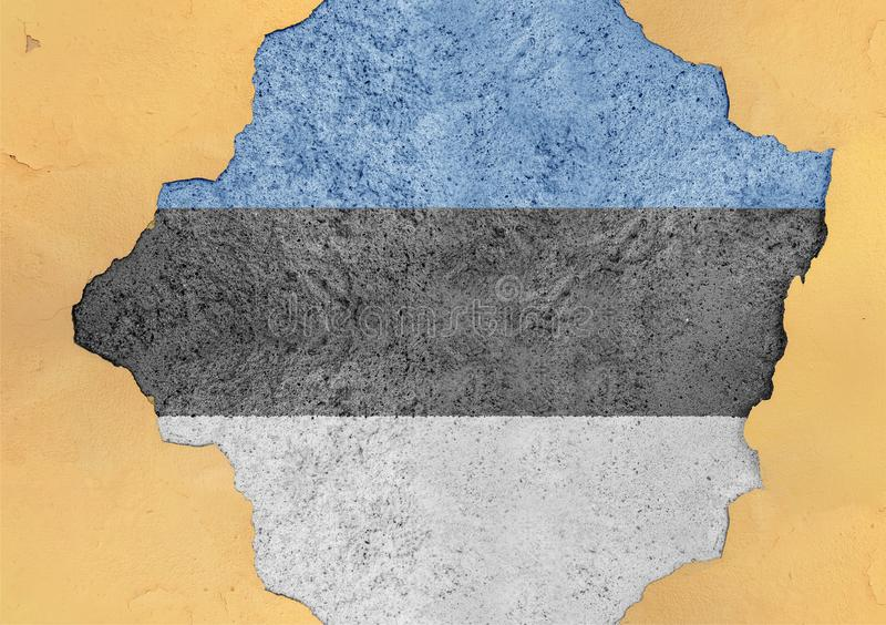Estonia cracked hole and broken flag in big concrete material facade. Structure royalty free stock photography