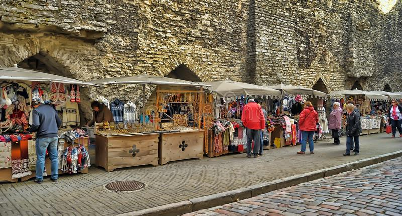 Street market with souvenirs and knitted things. Estonia, Tallinn, 10,10,2014 Street market with souvenirs and knitted things royalty free stock photo