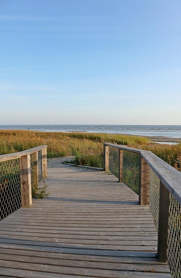 Estonia travel wild nature sunset beach wooden boardwalk to the baltic sea royalty free stock photography