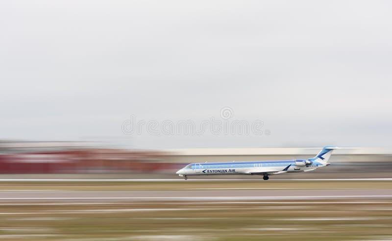 Estonian Air airplane at runway stock image