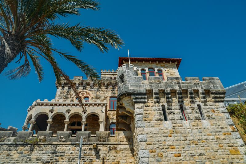 Estoril on Lisbon`s Sunshine coast - Historical fortified Baronial mansion overlooking the beach royalty free stock photography