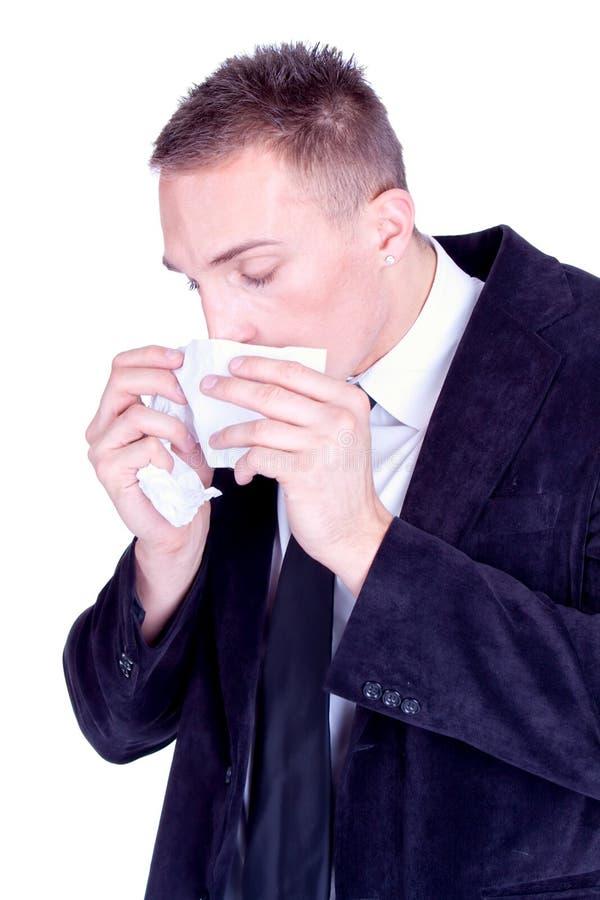 Estornudo… Hombre de negocios con una gripe imagen de archivo libre de regalías