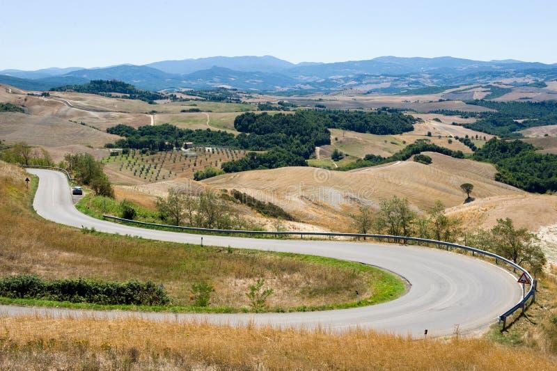Estrada através de Toscânia em Italy foto de stock royalty free