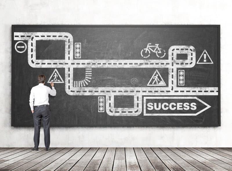 Estrada do desenho do homem de negócios ao sucesso fotos de stock