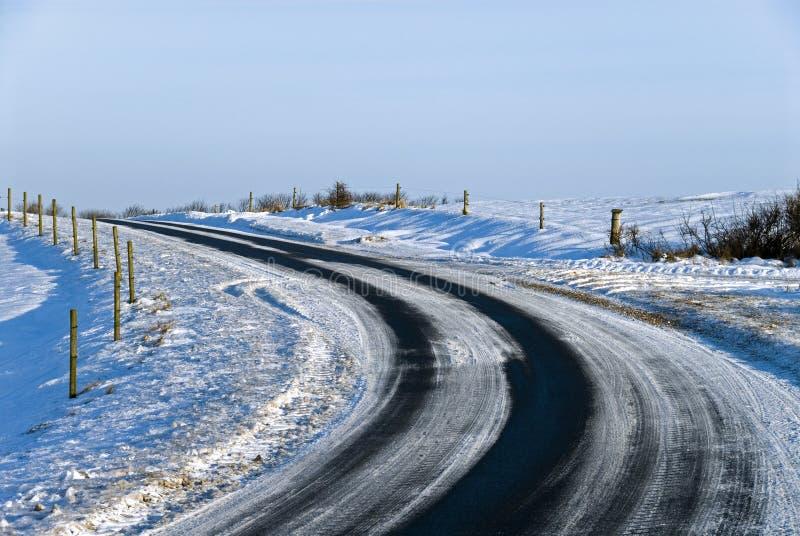 Estrada do inverno da curva imagem de stock royalty free