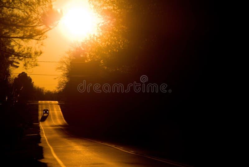 Estrada do por do sol fotos de stock