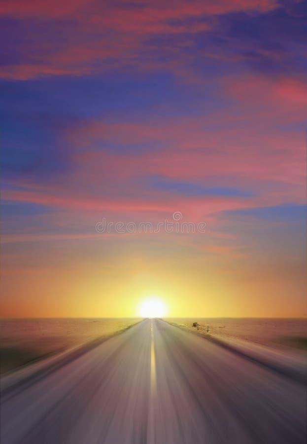 Estrada do por do sol fotografia de stock