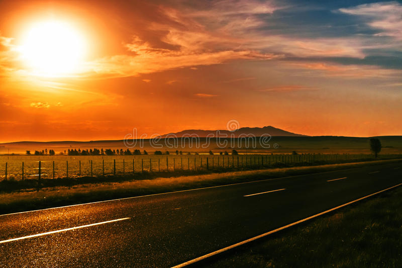 Estrada do por do sol fotos de stock royalty free