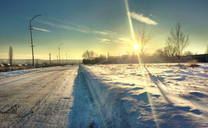 Estrada do por do sol no inverno foto de stock royalty free