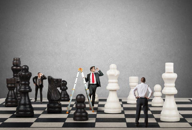 Estrategia y táctica en negocio imagen de archivo