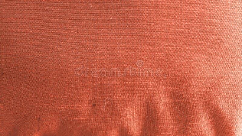Estratto alto vicino del fondo del tessuto del raso o della seta del tessuto del panno di tela di tessuto leggero con il modello  immagine stock libera da diritti