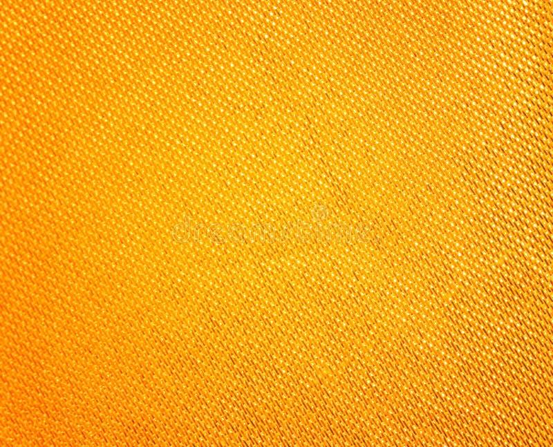 Estratto brillante del tessuto dell'oro, modelli variopinti di scintillio di struttura per fondo fotografia stock