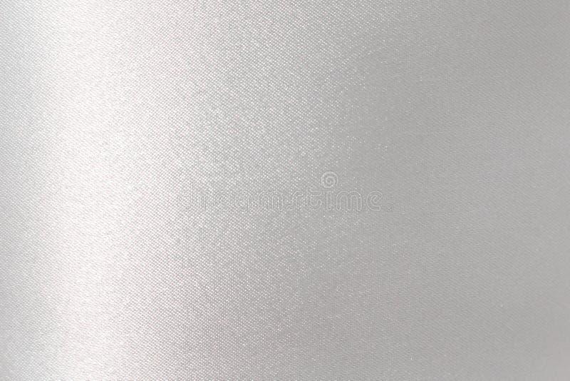 Estratto d'argento brillante del tessuto, modelli grigi di scintillio di struttura per fondo fotografie stock